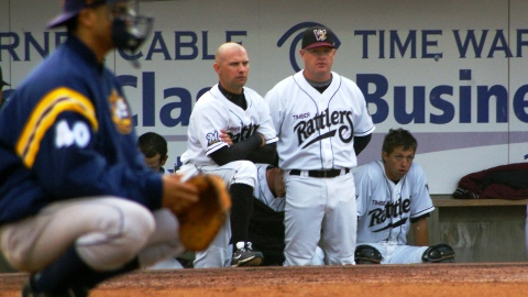 New Rattlers manager Matt Erickson (L) and former Rattlers manager Jeff Isom (R) survey the field from the home dugout during a 2010 game at Time Warner Cable Field.