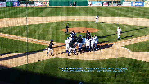 Mike Walker jumps into a mob of teammates after his game-ending home run to beat the Peoria Chiefs in game two of Sunday's doubleheader.