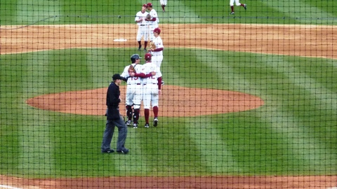 Austin Ross is congratulated by Tony Pechek after the final out of Ross's complete game victory over Quad Cities in the nightcap of Wednesday's doubleheader at Time Warner Cable Field.