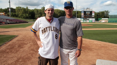 Timber Rattlers manager Matt Erickson poses with the winner of his Brewers Sunday jersey.